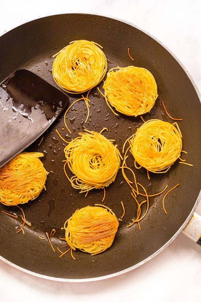 toasting vermicelli noodles in a skillet
