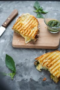 Golden, melty, delicious grilled cheese with pesto on sourdough