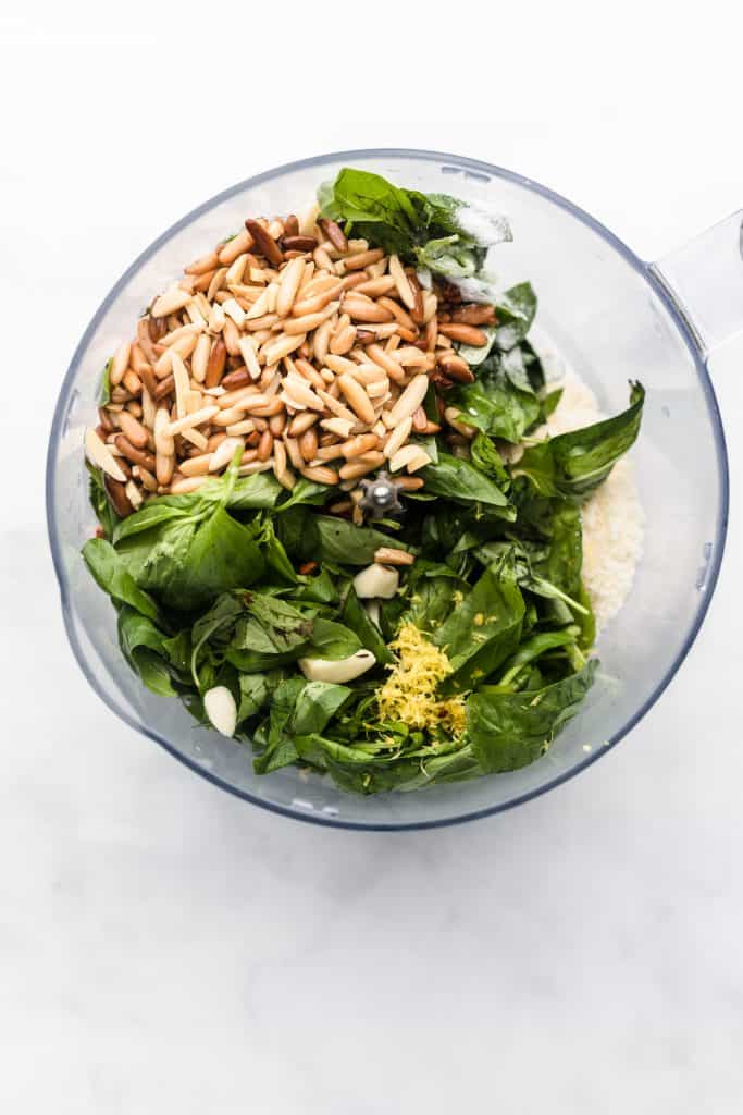 Ingredients for homemade pesto sauce in a blender