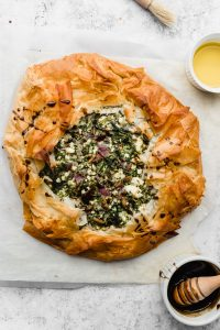 Baked greek spinach pie spanokopita with pomegranate molasses glaze on the side