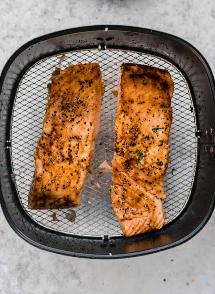 Air fryer salmon cooked in air fryer basket