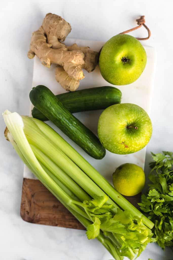 Cut up fruits and vegetables for green juice recipe