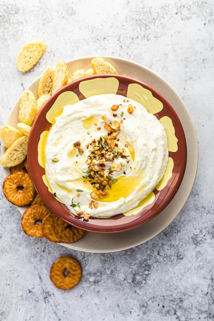 Greek feta dip in a bowl with pretzels and chips