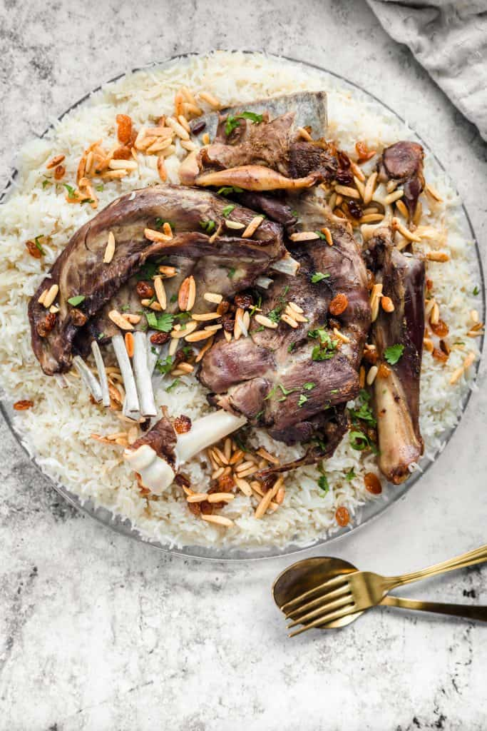 Lamb mandi on top of rice with toasted nuts