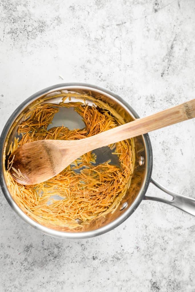 toasted vermicelli in olive oil in a saucepan