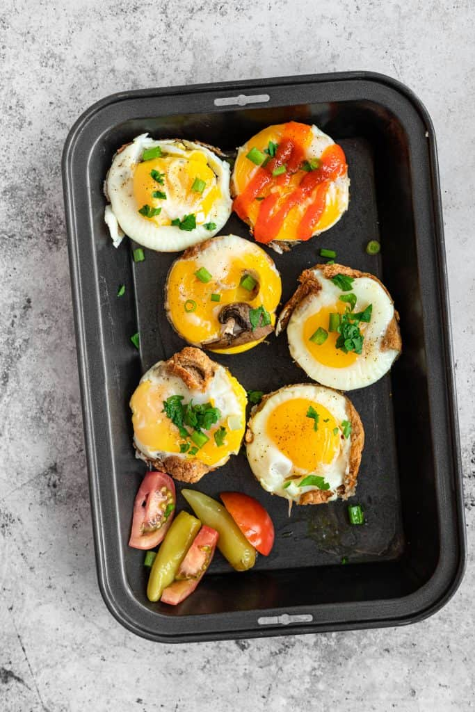 baked egg cups in a pan with toppings