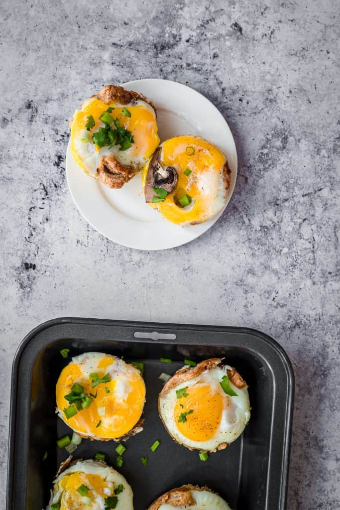 egg cups on a plate with more on a tray