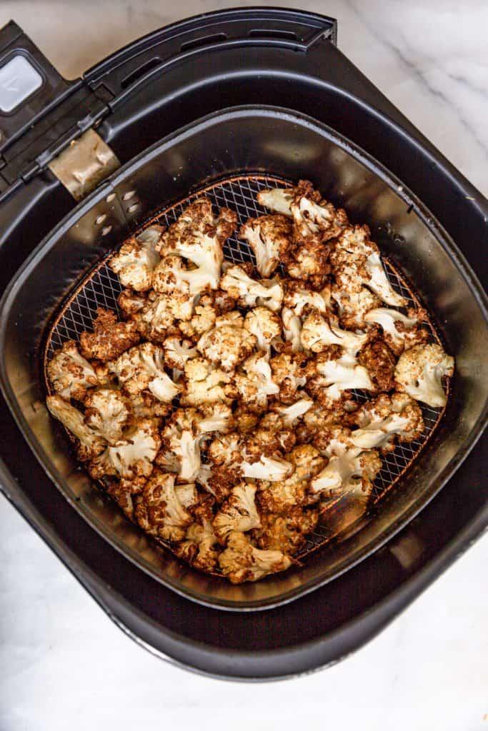 crispy golden cauliflower in air fryer basket