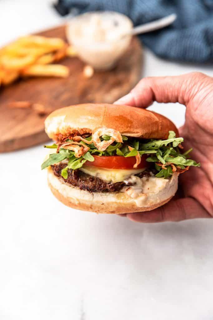 air fryer burger held in hand