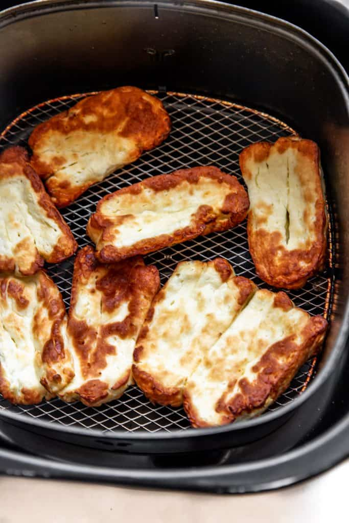 halloumi slices in air fryer after cooking