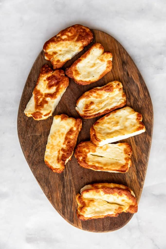 air fried halloumi slices on wooden board