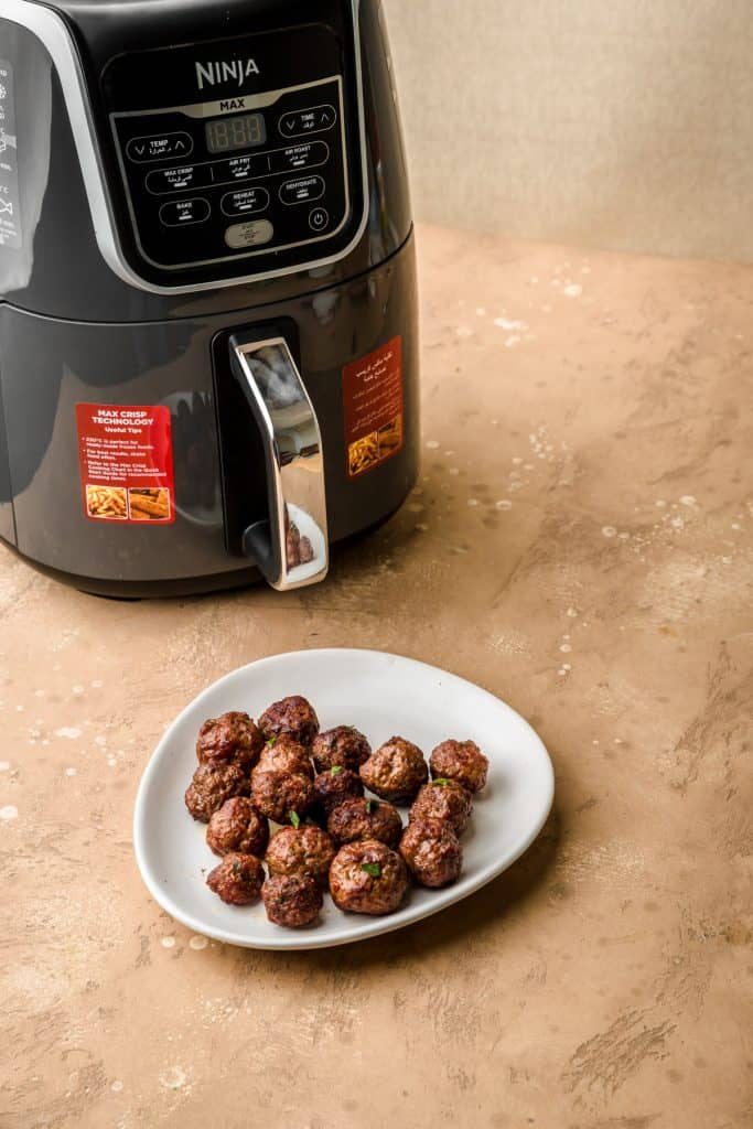 kafta meatballs with air fryer in background