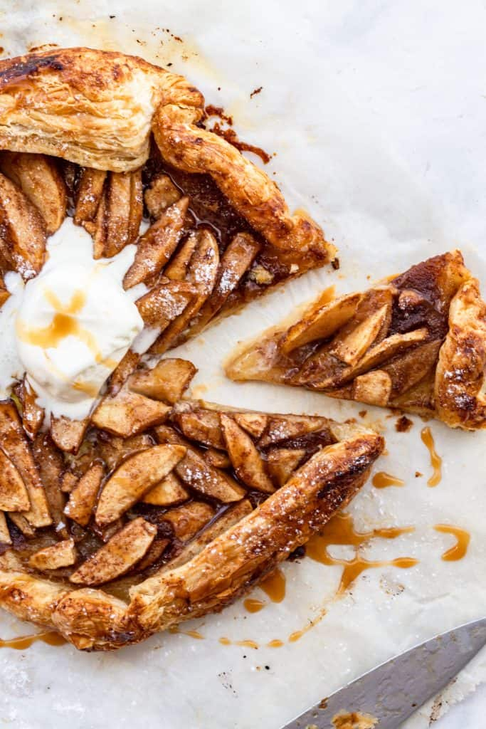 baked puff pastry apple galette with knife in the corner