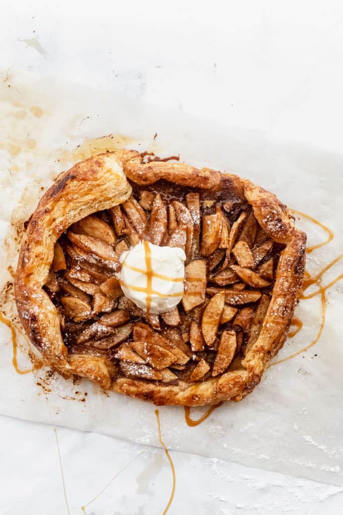 completed puff pastry apple galette with caramel drizzled on top