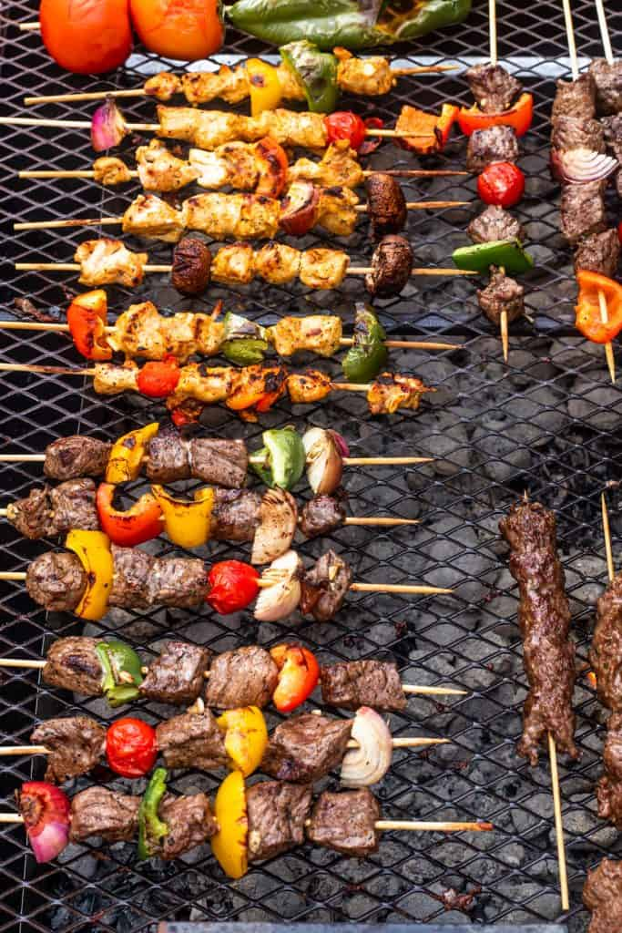 Arabic grills being cooked on a bbq