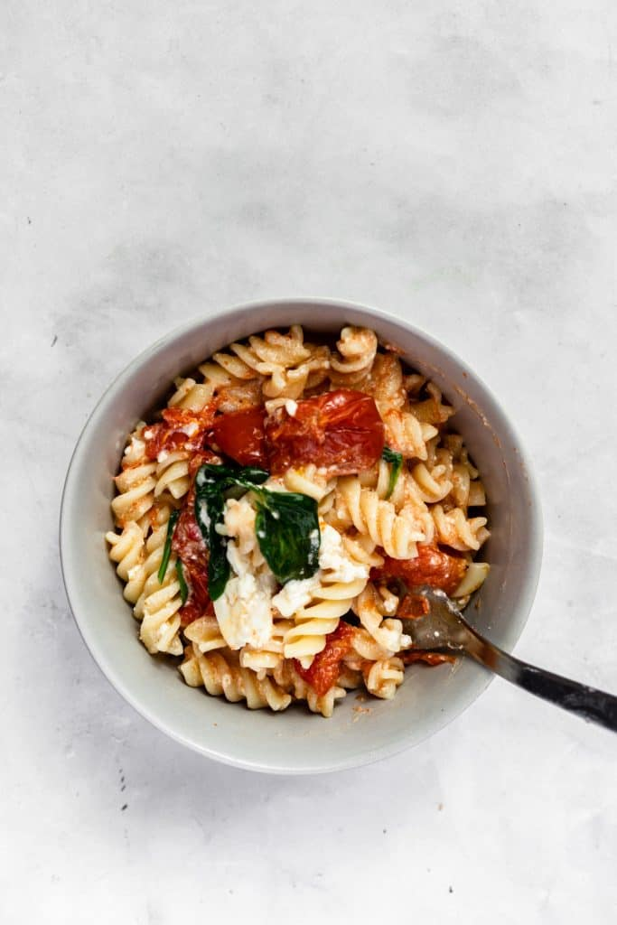 bowl of creamy baked feta pasta with a spoon