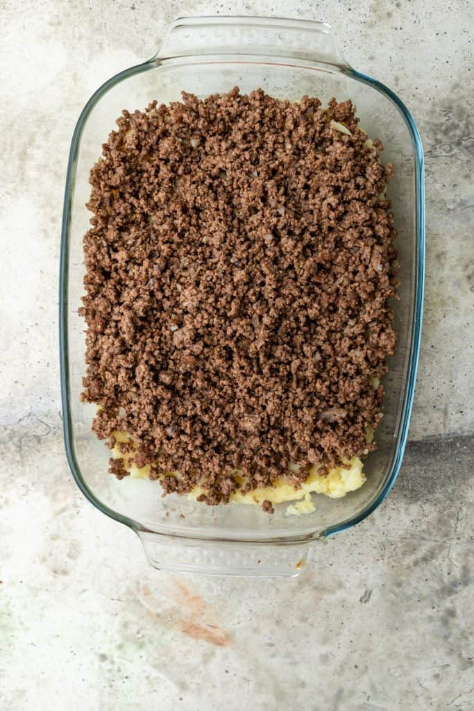 layer of ground beef over mashed potatoes