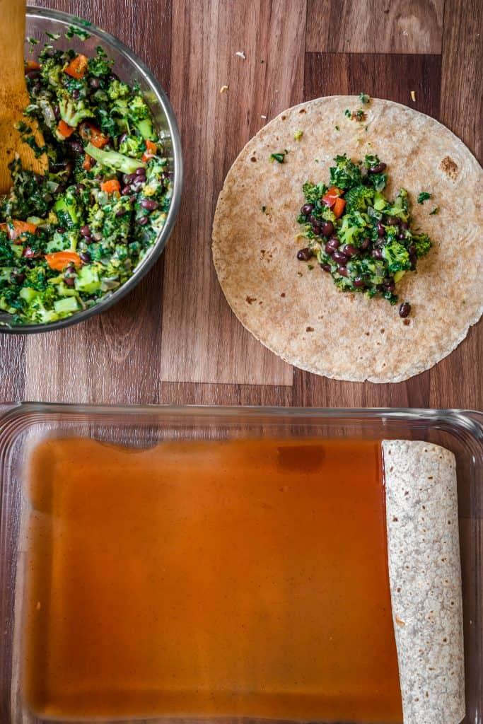 a tortilla with filling on it and a pyrex bowl of more filling on the side