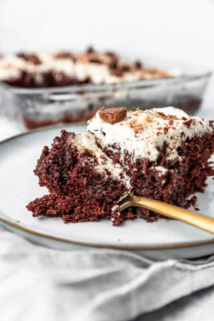 chocolate cake with condensed milk with a fork taking a bite out