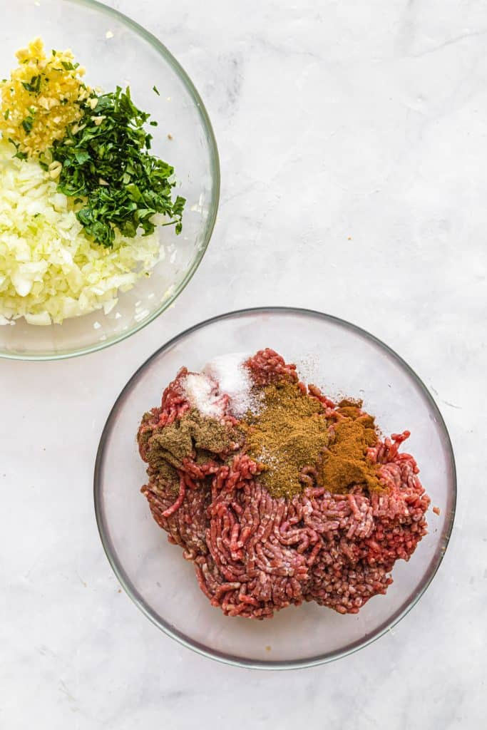 raw beef to make lebanese meatballs in a bowl