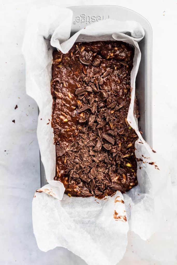 chocolate zucchini cake batter in loaf pan