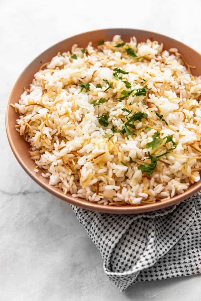 Bowl of egyptian rice with vermicelli in a tan bowl
