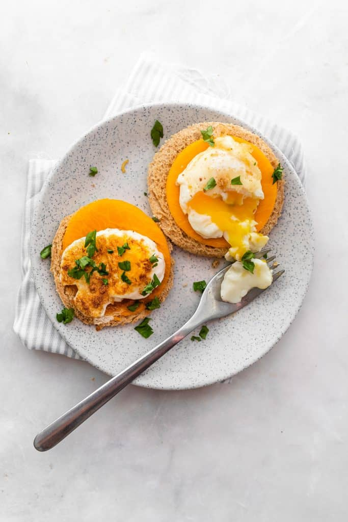 froached eggs on toast on a plate