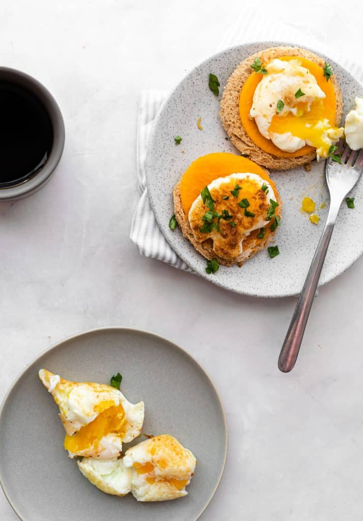 eggs on a plate with coffee on the side