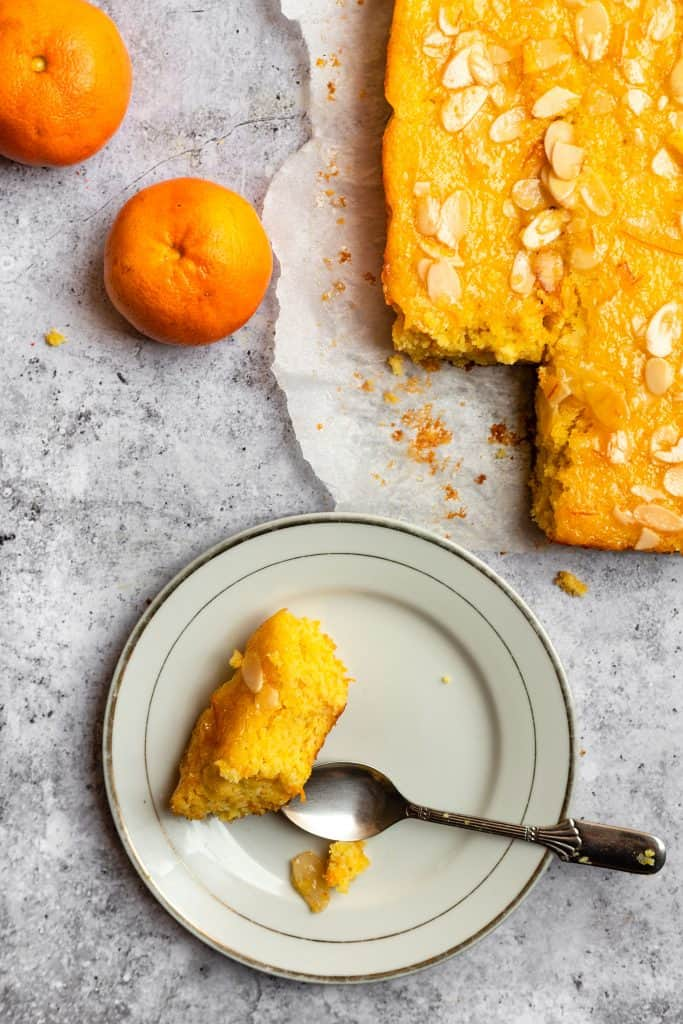 gluten free orange almond cake with a slice cut out