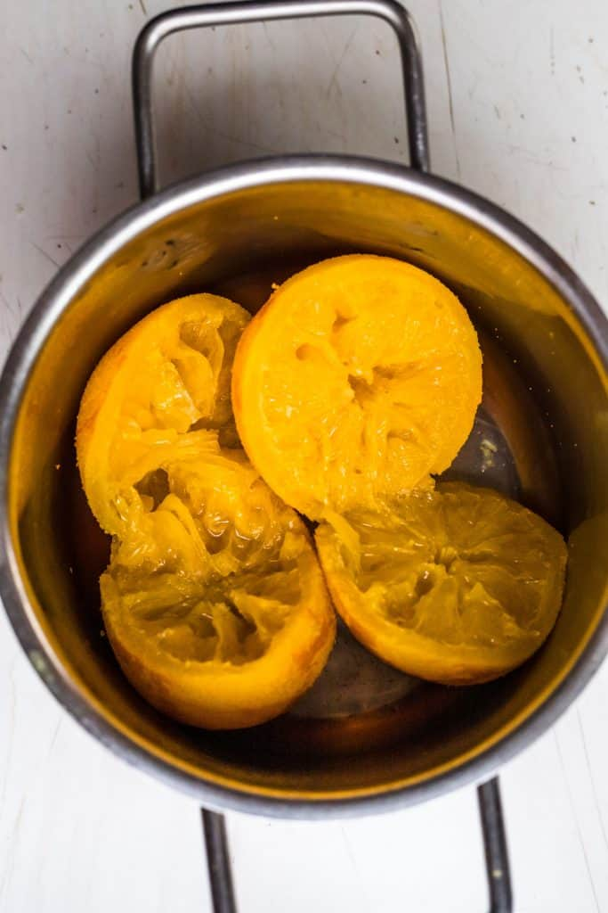 the boiled oranges for using to make the cake in a pot