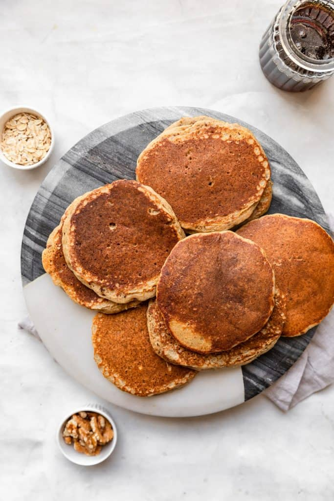 top shot of harvest grain and nut pancakes on white marble platter