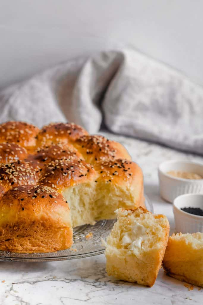 honeycomb bread with a bun broken in half