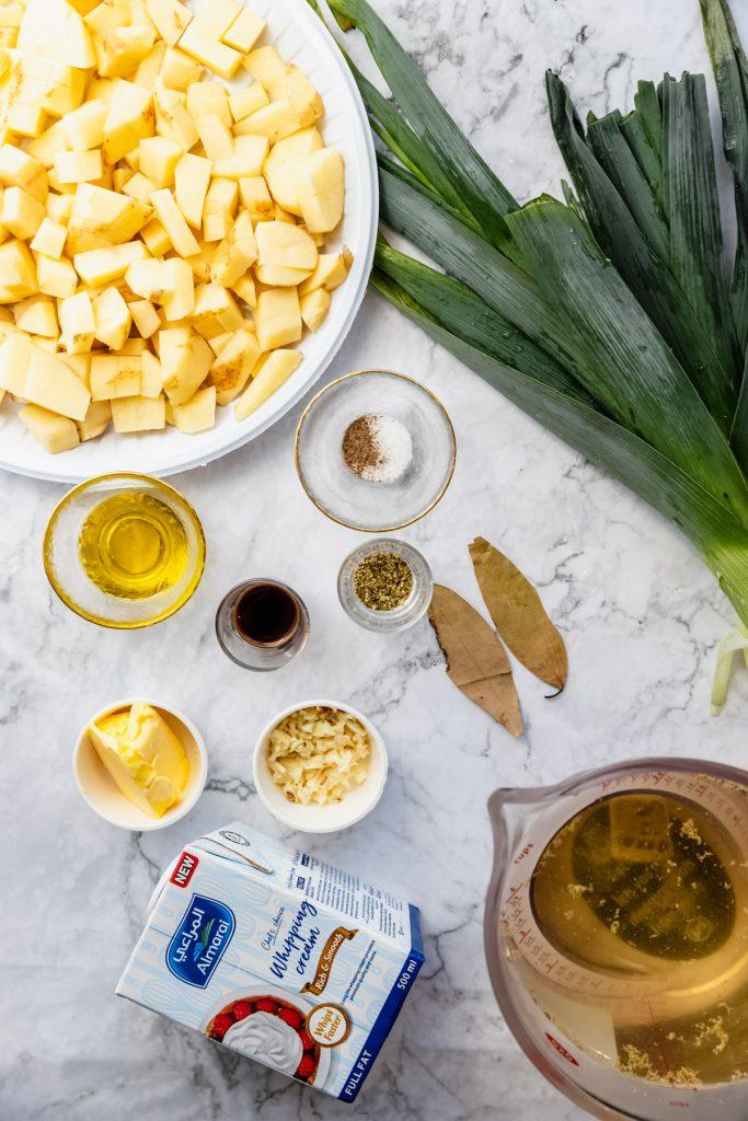 ingredients needed for potato leek soup in little bowls