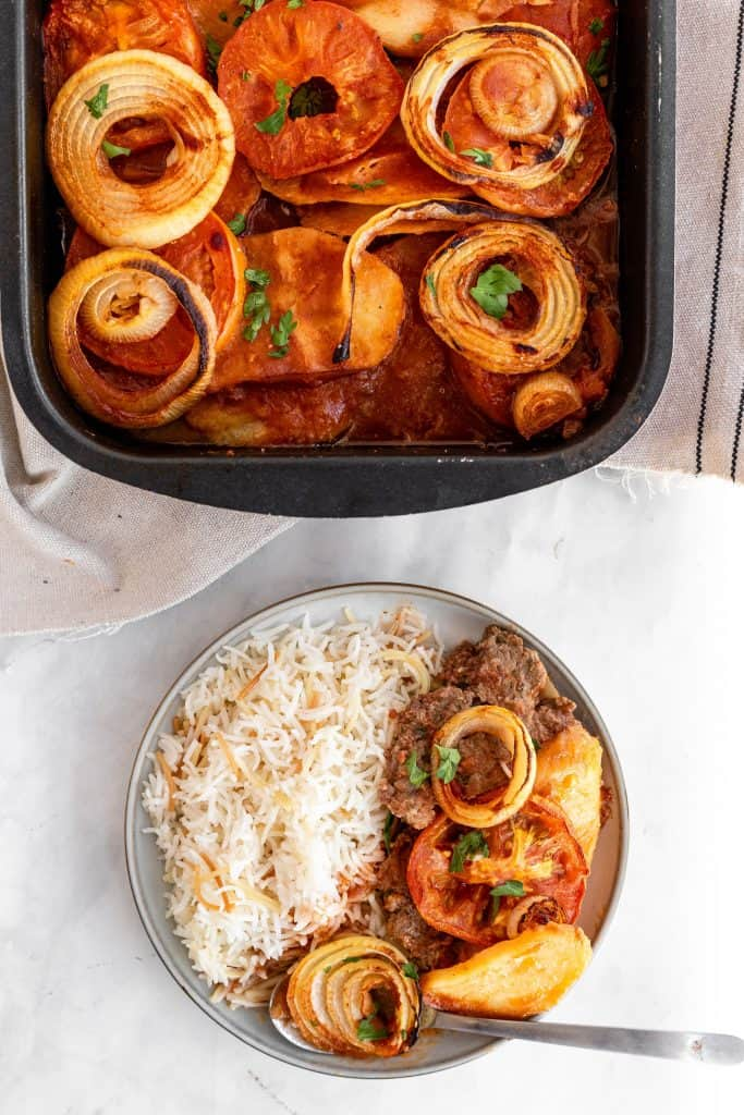 baked kafta in a pan with a side of rice