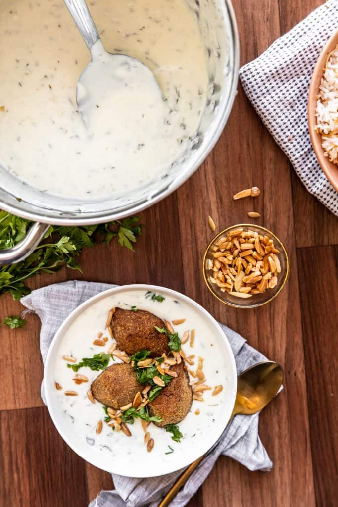 kibbeh labanieh  cooked laban sauce in a saucepan with vermicelli rice and kebbe bil laban