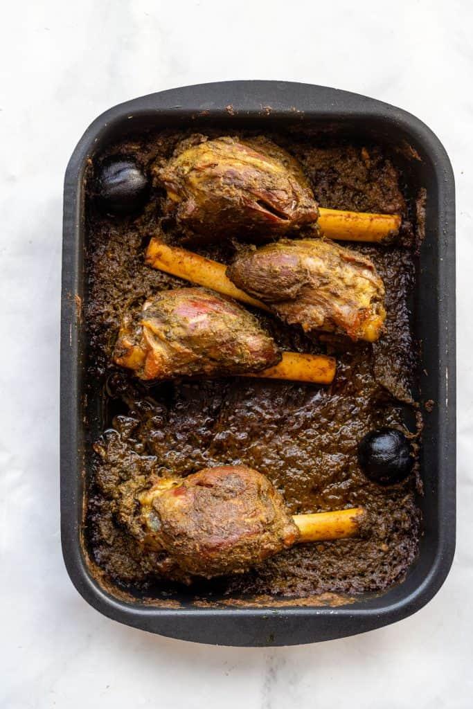 roasted lamb shanks in the pan, yemeni style