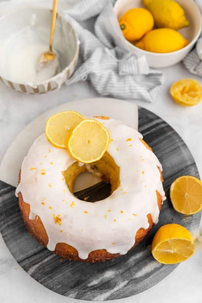 lemon iced cake on marble cake plate