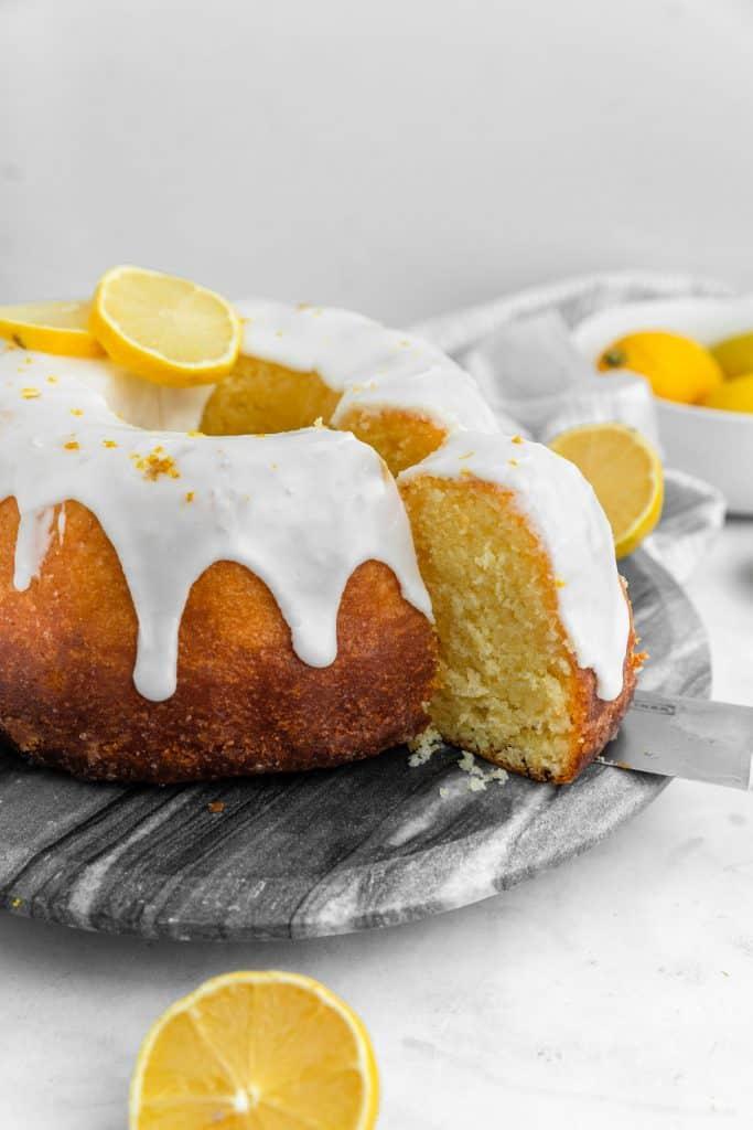 close up shot of a knife cutting lemon bliss cake