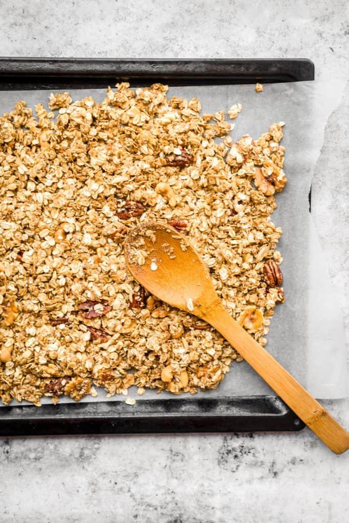tahini granola on baking sheet before being baked