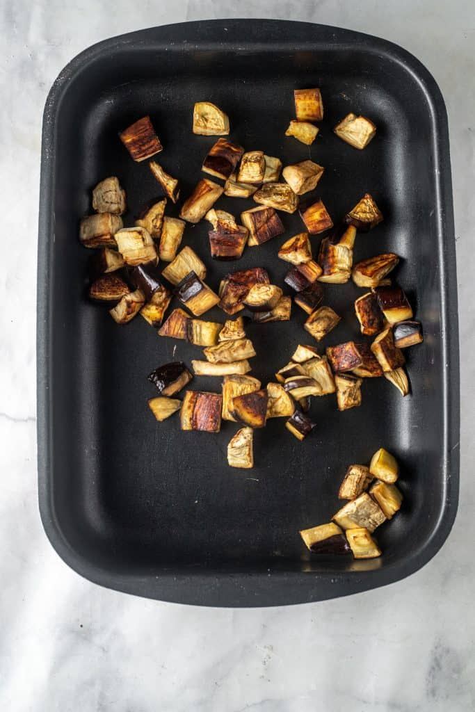 Roasted eggplant cubes in pan